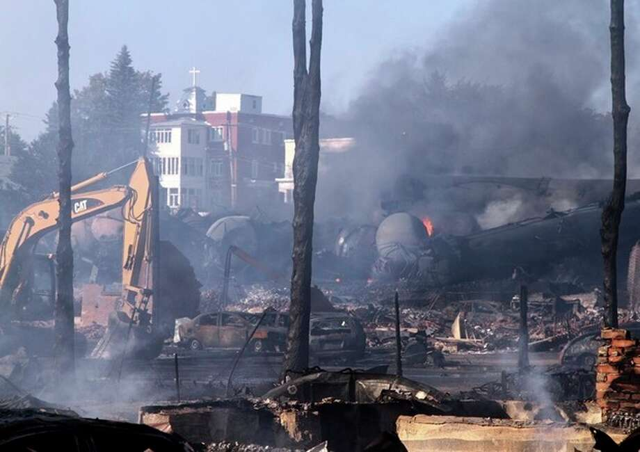 In a Monday, July 8, 2013 photo provided by Surete du Quebec via The Canadian Press, the downtown core lies in ruins in Lac-Megantic, Quebec, in a Surete du Quebec. Thirteen people are confirmed dead and forty more are listed as missing after a train derailed ignited tanker cars carrying crude oil. (AP Photo/Surete du Quebec via The Canadian Press) / Surete du Quebec via The Canadian Press
