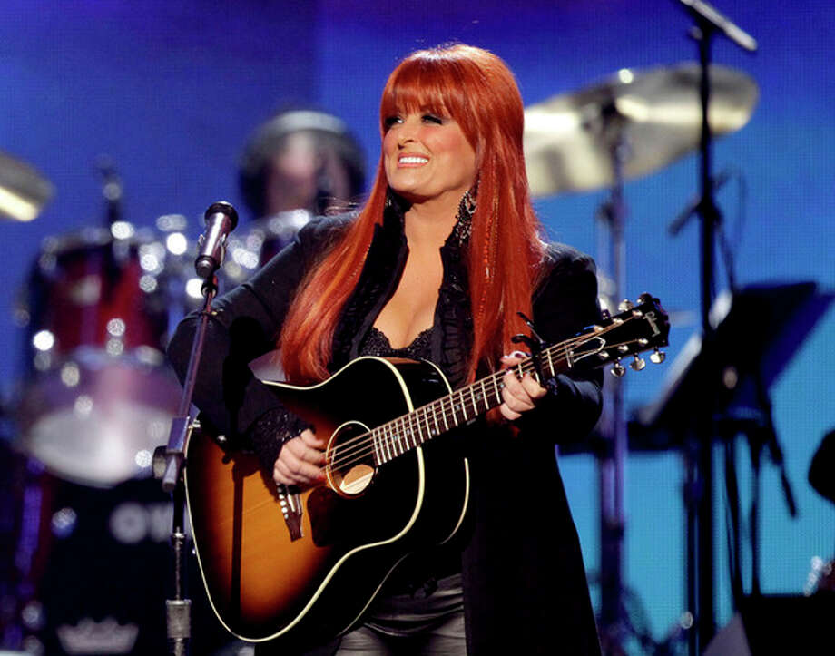 FILE - This April 4, 2011 file photo shows country winger Wynonna Judd from The Judds, performing at the Girls' Night Out: Superstar Women of Country in Las Vegas. Judd says she is postponing scheduled concerts in Canada next week after her husband was hurt in a motorcycling accident in South Dakota, Saturday, Aug. 19, 2012. (AP Photo/Julie Jacobson, file) / AP