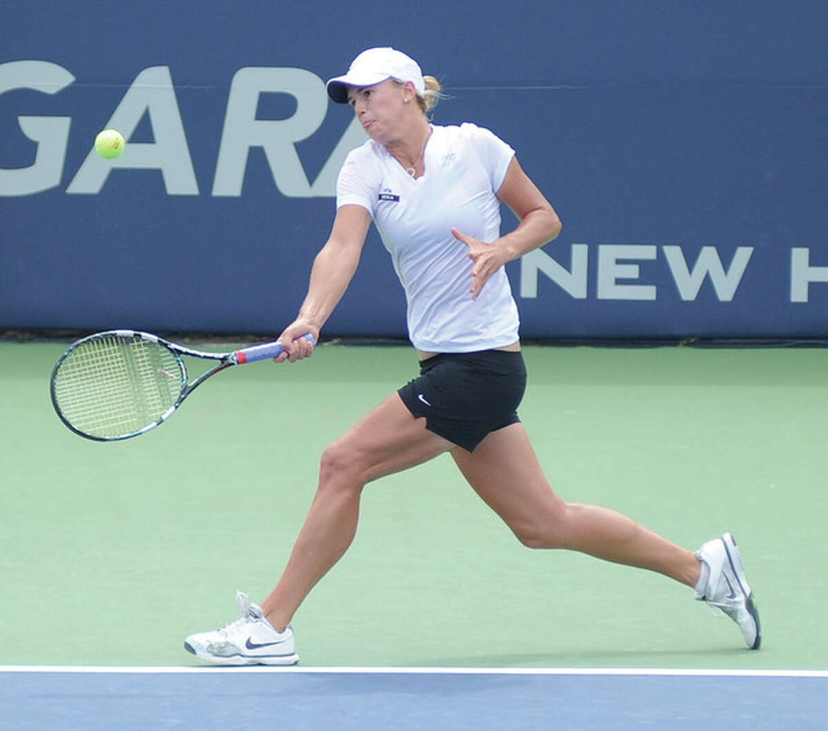 Hour photo/John Nash Alexa Glatch tracks down a forehand return during her third round qualifying match against Melanie Oudin on Sunday. Glatch notched a 6-0, 6-2 win to make the main draw at the New Haven Open.