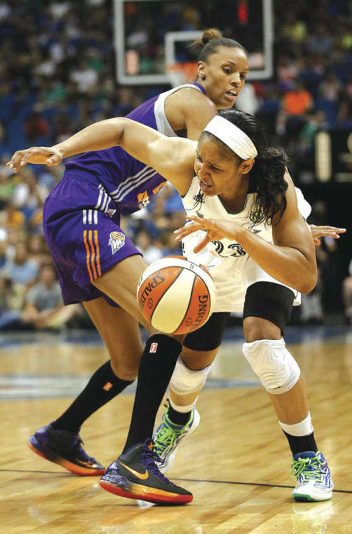 AP photo Minnesota forward Maya Moore tries to drive around DeWanna Bonner of Phoenix during Tuesday's showdown ofthe WNBA's two division leaders.