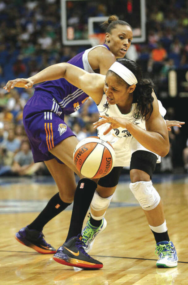 AP photoMinnesota forward Maya Moore tries to drive around DeWanna Bonner of Phoenix during Tuesday's showdown ofthe WNBA's two division leaders.