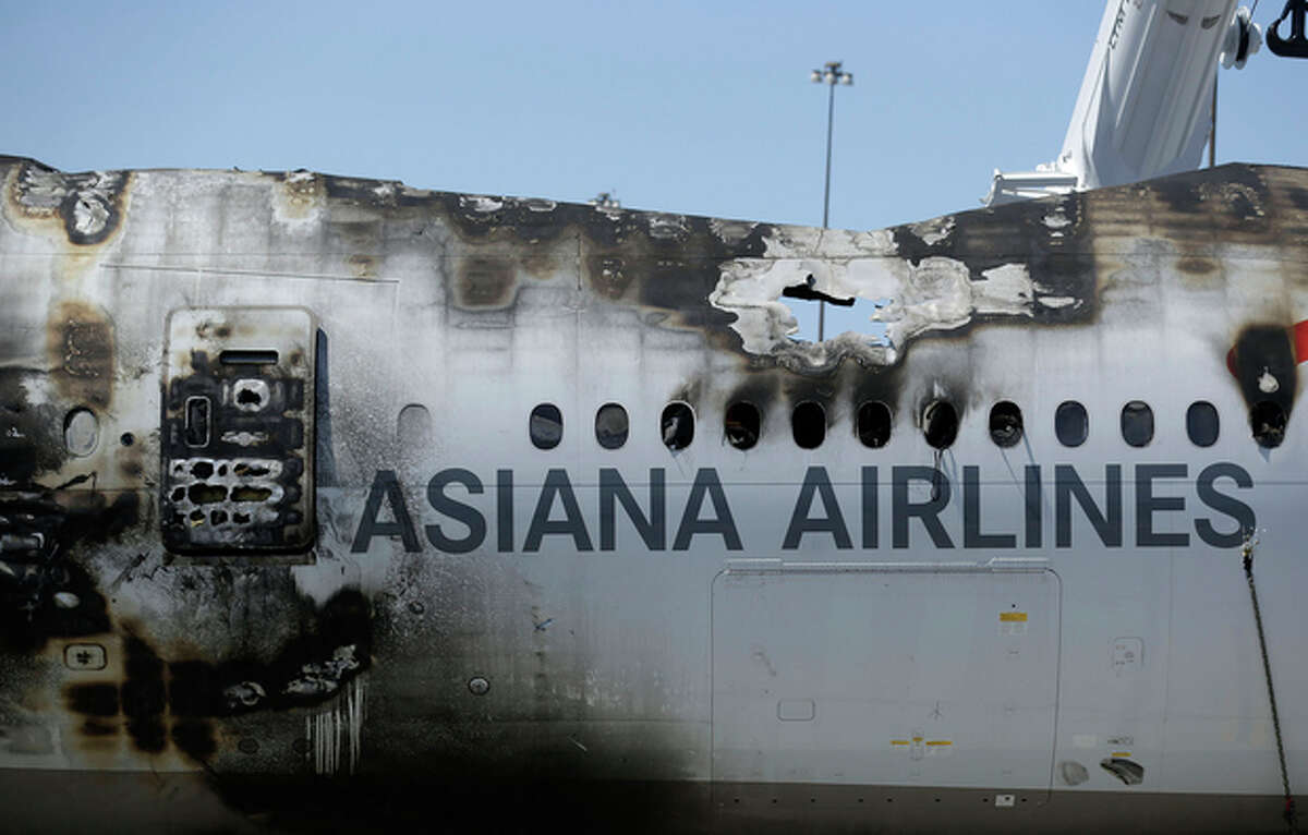 The wreckage of Asiana Flight 214, which crashed on Saturday, July 6, 2013, seen at San Francisco International Airport, in San Francisco, Friday, July 12, 2013. Two people were killed and dozens of others injured although most suffered minor injuries. Investigators have said the plane came in too low and slow. (AP Photo/Jeff Chiu)