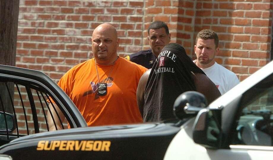 Hour Photo/ Alex von Kleydorff. Norwalk Police put a suspect into custody on Day street after a stabbing on Bedford st ealier on Monday