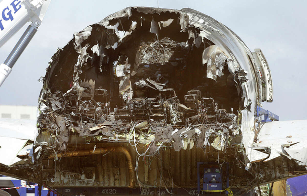 The rear of Asiana Flight 214, which crashed on Saturday, July 6, 2013, is seen at San Francisco International Airport, in San Francisco, Friday, July 12, 2013. Two people were killed and dozens of others injured although most suffered minor injuries. Investigators have said the plane came in too low and slow. (AP Photo/Jeff Chiu)