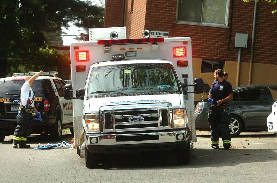Hour Photo/ Alex von Kleydorff. Stabbing victim on Bedford Ave is transported to Norwalk Hospital