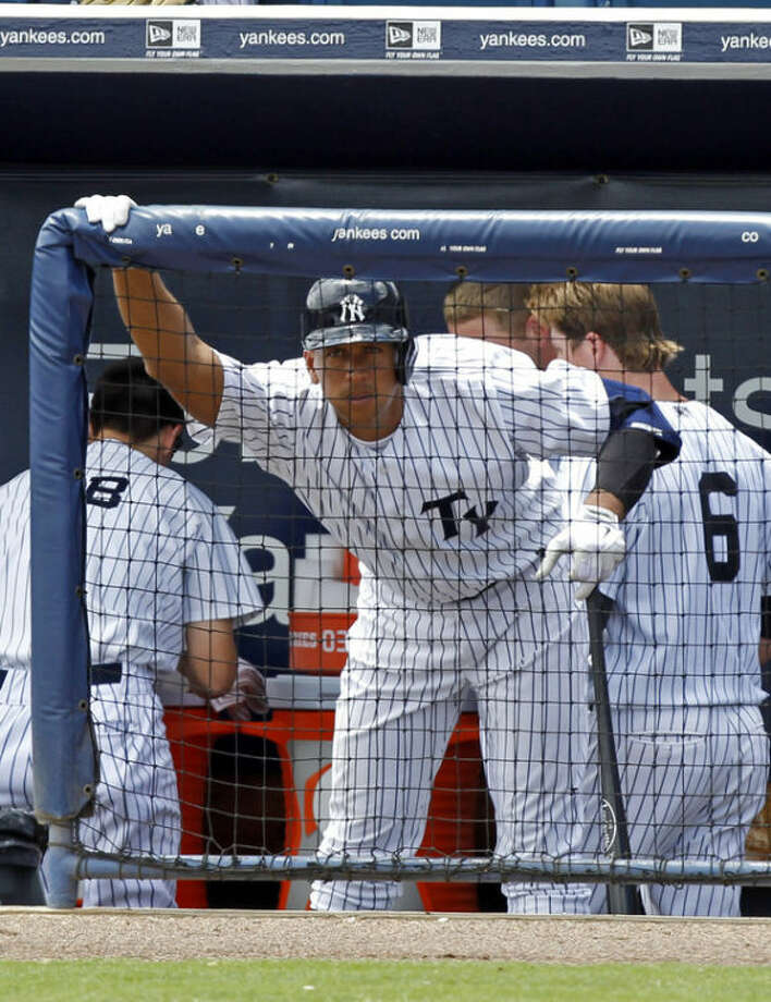 New York Yankees' Alex Rodriquez stretches before batting in the fourth inning for the Tampa Yankees against the Dunedin Blue Jays in a minor league rehab game in Tampa, Fla., Wednesday, July 10, 2013. (AP Photo/Scott Iskowitz)