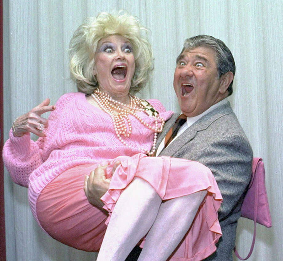 FILE-In this Oct. 9, 1985, file photo, Comedian Phyllis Diller gets a lift from emcee Buddy Hackett prior to the celebrity stag luncheon roast at the New York Friars Club in New York City. Diller, the housewife turned humorist who aimed some of her sharpest barbs at herself, died Monday, Aug. 20, 2012, at age 95 in Los Angeles.(AP Photo/Marty Lederhandler, File) / AP