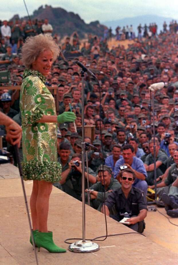 FILE-In this Jan. 6, 1967 file photo, comedian Phyllis Diller performs during the Bob Hope show for American troops at Can Ranh Bay, South Vietnam. Diller, the housewife turned humorist who aimed some of her sharpest barbs at herself, died Monday, Aug. 20, 2012, at age 95 in Los Angeles. (AP Photo/File)