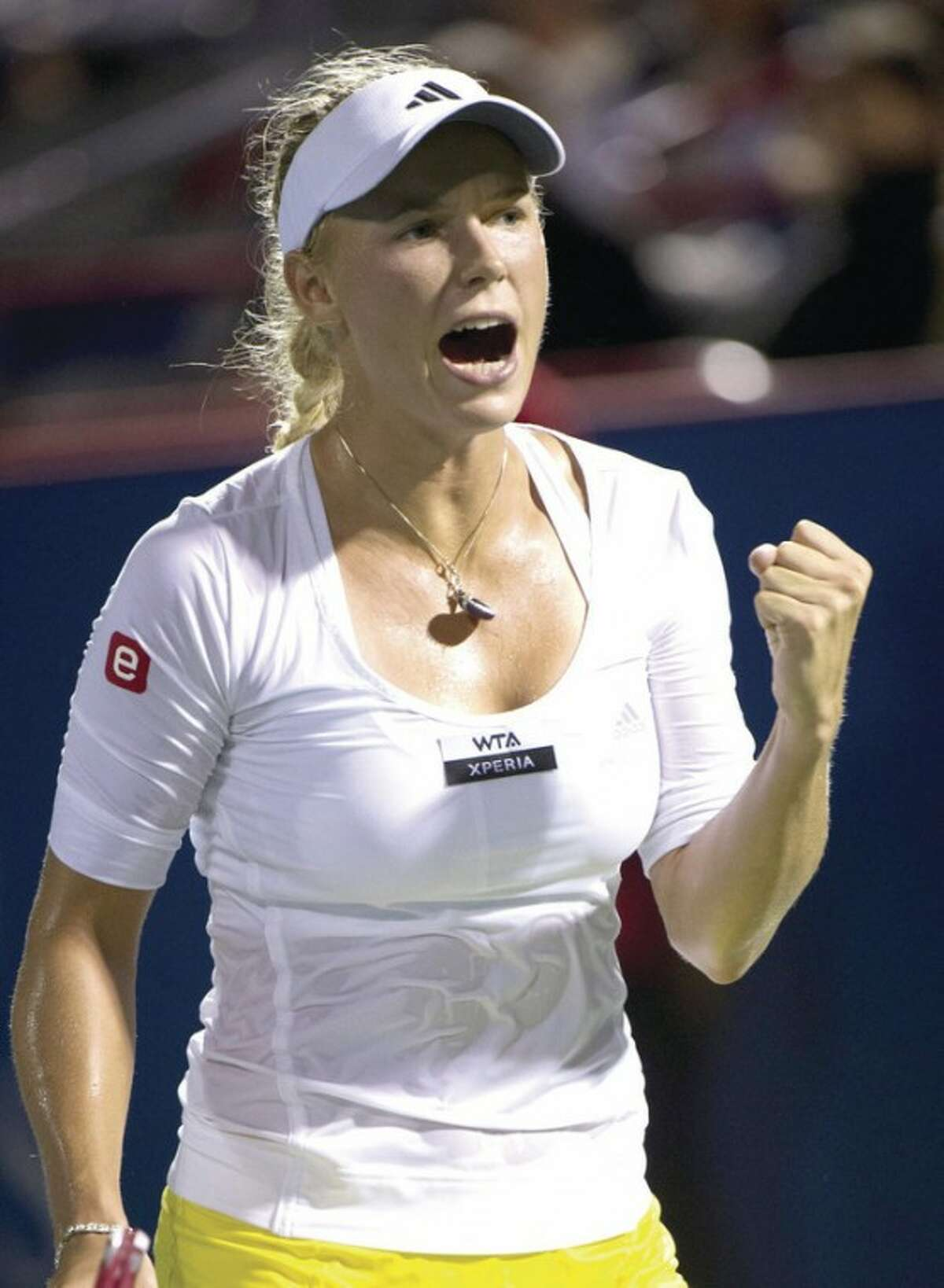AP photo Caroline Wozniacki, from Denmark, celebrates a point over during a quarterfinal match at the Rogers Cup women's tennis tournament earlier this month. This week, Wozniacki is looking to win her fifth New Haven Open and won her opening match on Monday.