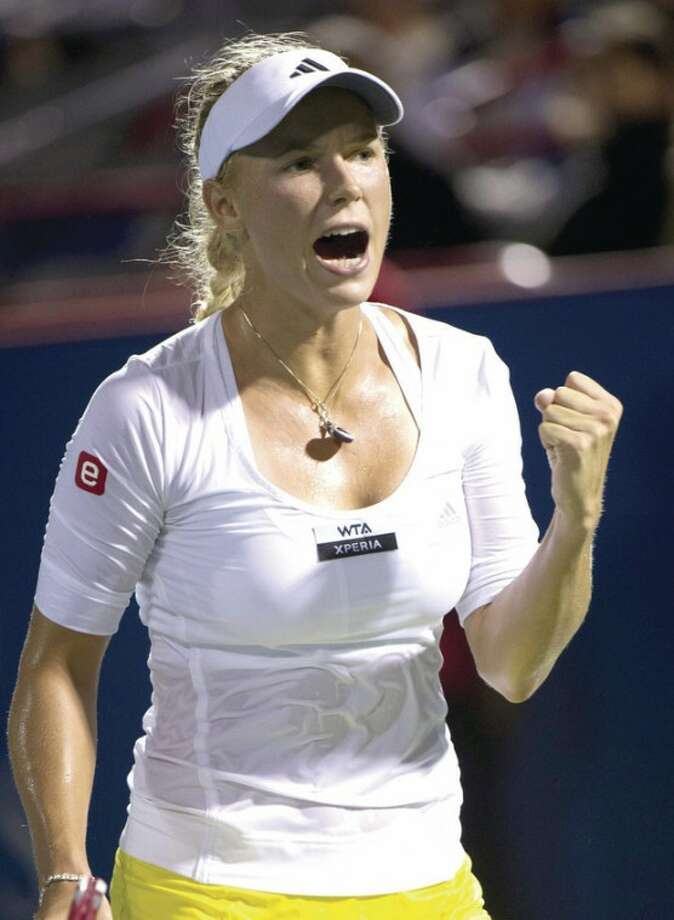 AP photoCaroline Wozniacki, from Denmark, celebrates a point over during a quarterfinal match at the Rogers Cup women's tennis tournament earlier this month. This week, Wozniacki is looking to win her fifth New Haven Open and won her opening match on Monday.