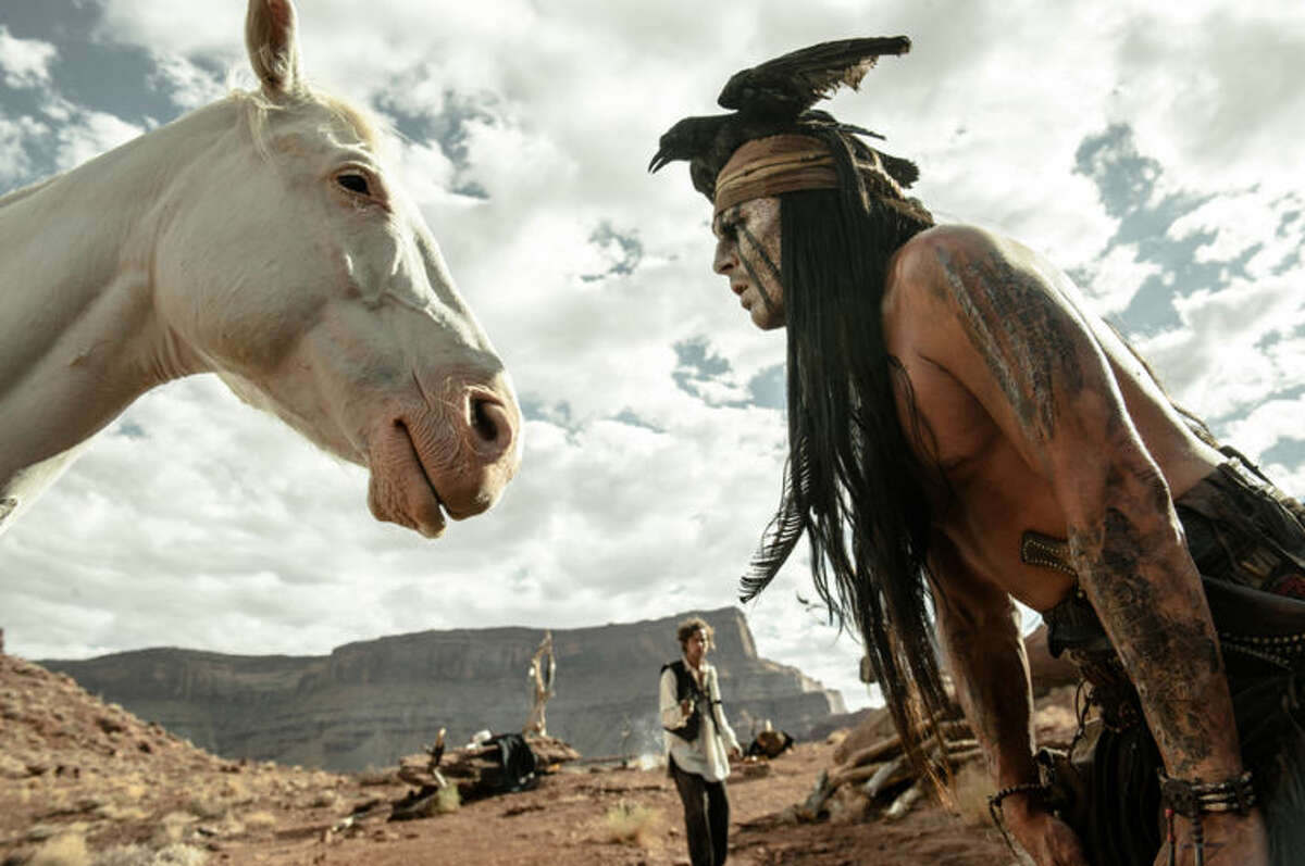 """FILE - This file publicity image released by Disney shows Johnny Depp, right, as Tonto, in a scene from """"The Lone Ranger."""" For months, questions have swirled about whether developers, activists or tribes would be willing to plunk down millions to buy the Wounded Knee National Landmark. Now there?•s a new potential buyer in the mix: Johnny Depp. (AP Photo/Disney Enterprises, Inc. and Jerry Bruckheimer Inc., Peter Mountain, File)"""