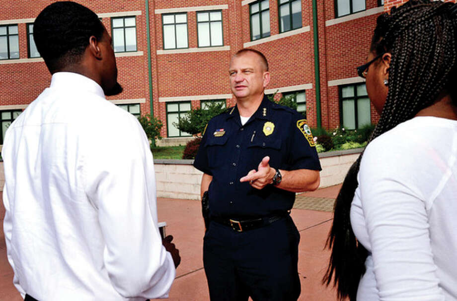 Hour photo / Erik TrautmannNorwalk Police Chief Thomas Kulhawik chats with residents outside the Norwalk Police Department headquarters on Monroe St. / (C)2013, The Hour Newspapers, all rights reserved