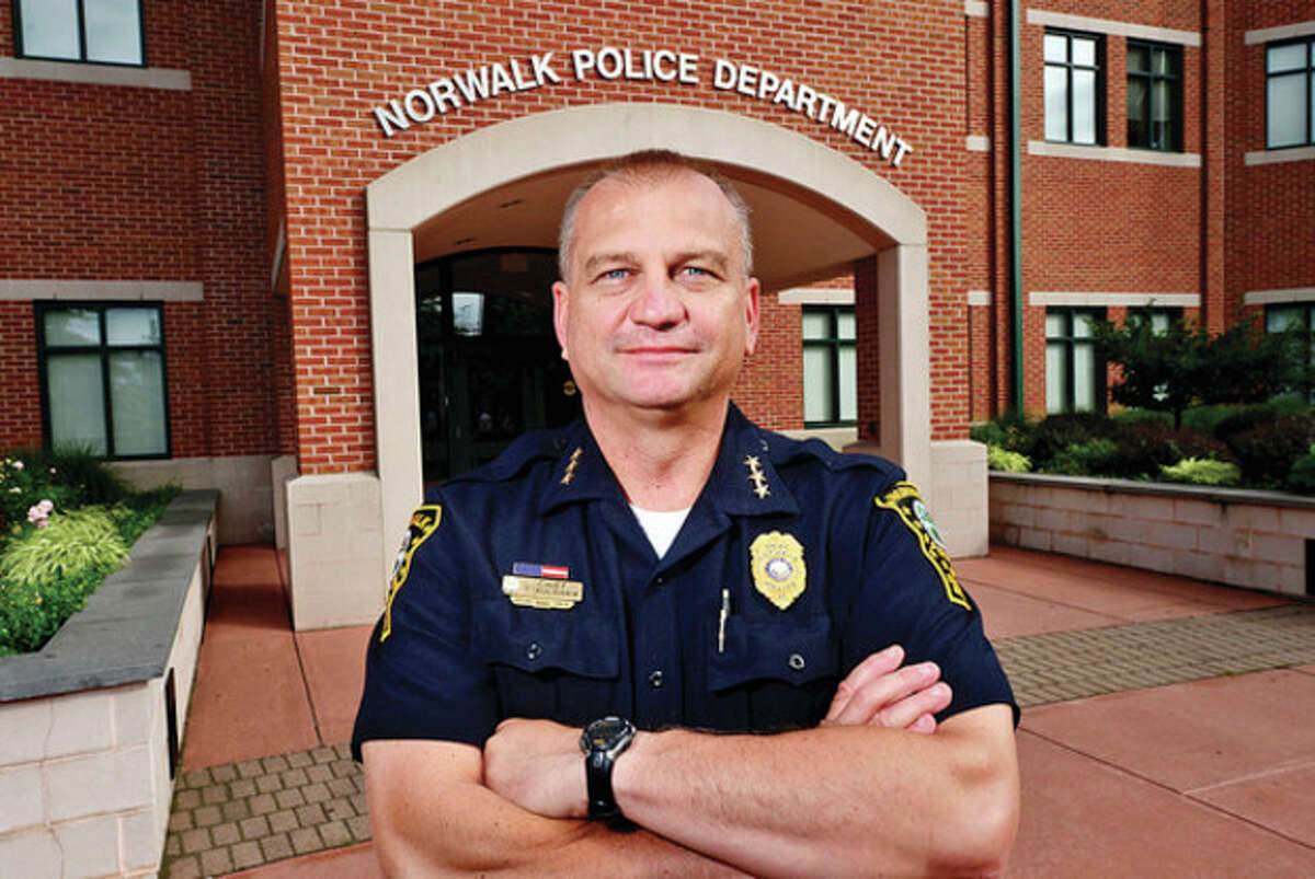 Hour photo / Erik Trautmann Norwalk Police Chief Thomas Kulhawik has completed his first year as chief.