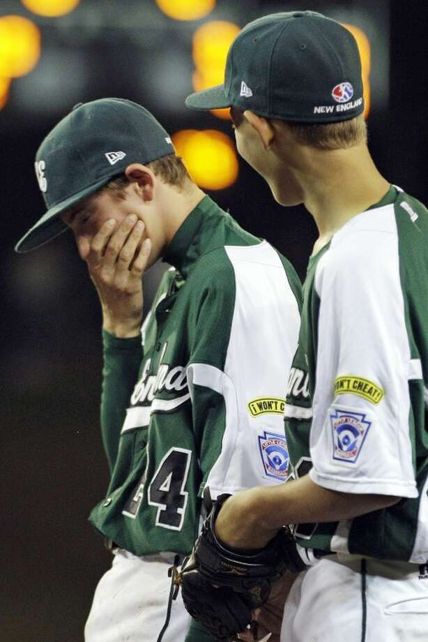 Fairfield, Conn., pitcher Will Lucas, left, reacts after pitching a no-hitter against New Castle, Ind., in an elimination baseball game at the Little League World Series tournament in South Williamsport, Pa., Monday, Aug. 20, 2012. Connecticut won 4-0. (AP Photo/Gene J. Puskar)