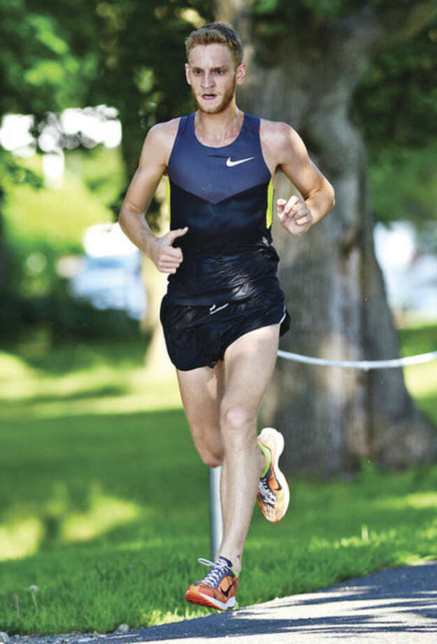 Hour photo/Erik TrautmannLuke McCambley is the first male finisher during the Westport Road Runners second race in a 10-race series at Longshore Park Saturday.Hour photo / Erik Trautmann
