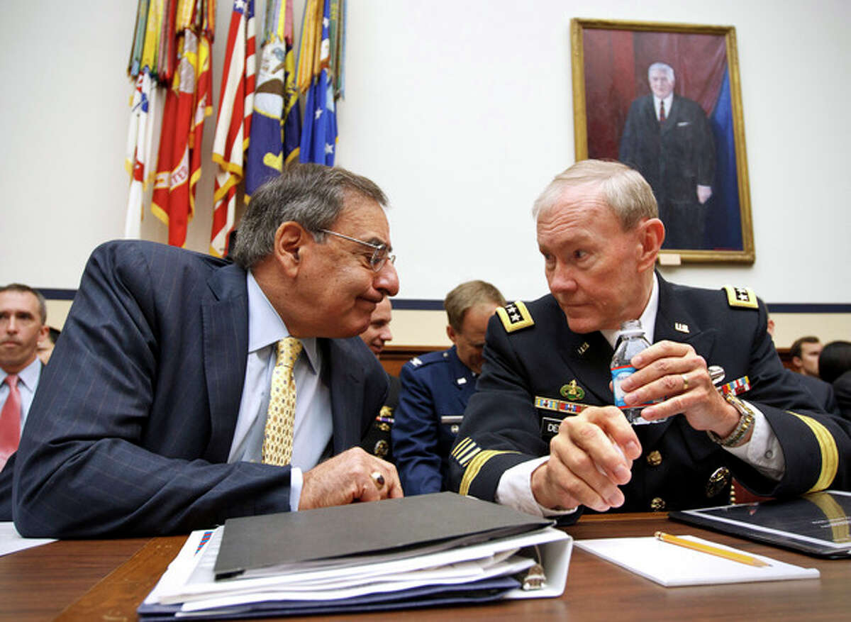 AP Photo/J. Scott Applewhite, File In this April 19, file photo, Defense Secretary Leon Panetta and Joint Chiefs Chairman Gen. Martin Dempsey confer on Capitol Hill in Washington prior to testifying.