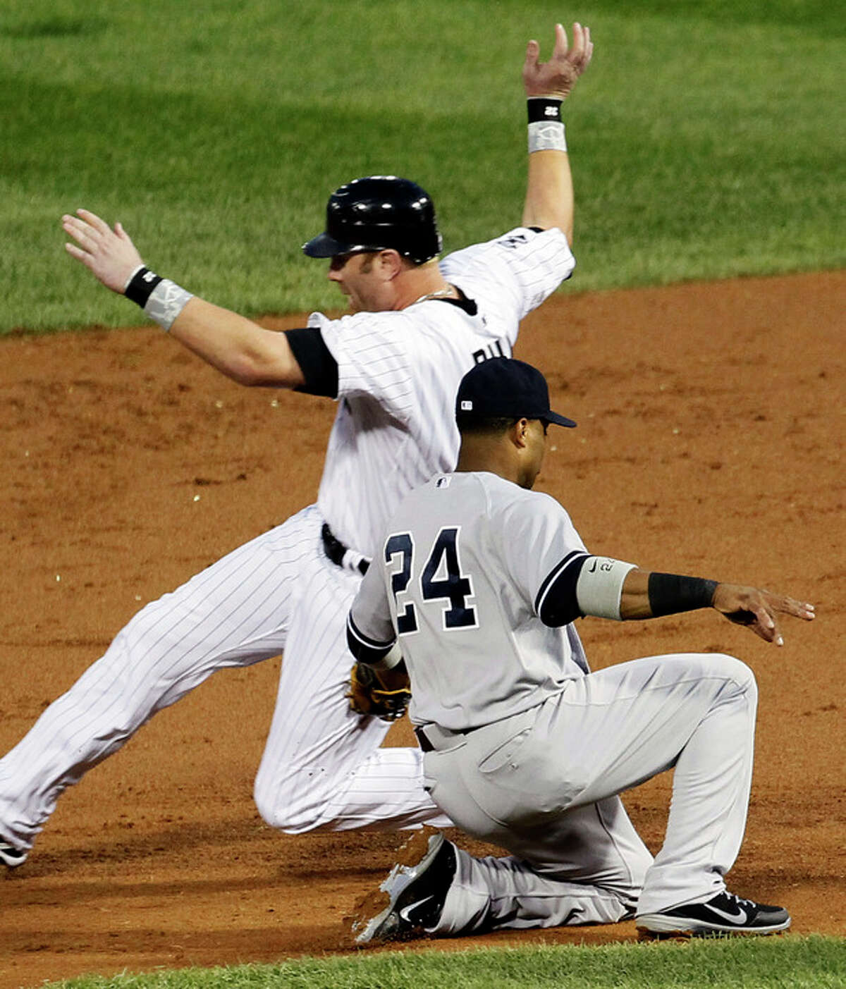 Chicago White Sox's Adam Dunn is caught stealing second by New York Yankees second baseman Robinson Cano (24) during the first inning of a baseball game, Monday, Aug. 20, 2012, in Chicago. (AP Photo/Charles Rex Arbogast)