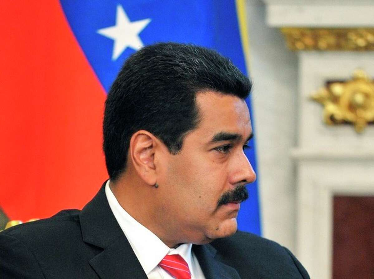 Venezuela's President Nicolas Maduro listens to Russian President Vladimir Putin, unseen, during their meeting at the Kremlin in Moscow, Tuesday, July 2, 2013. Maduro told Russian reporters on Tuesday that his country has not received an application for asylum from Snowden and dodged the question of whether he would take Snowden away with him.(AP Photo/RIA Novosti, Alexei Nikolsky, Presidential Press Service)