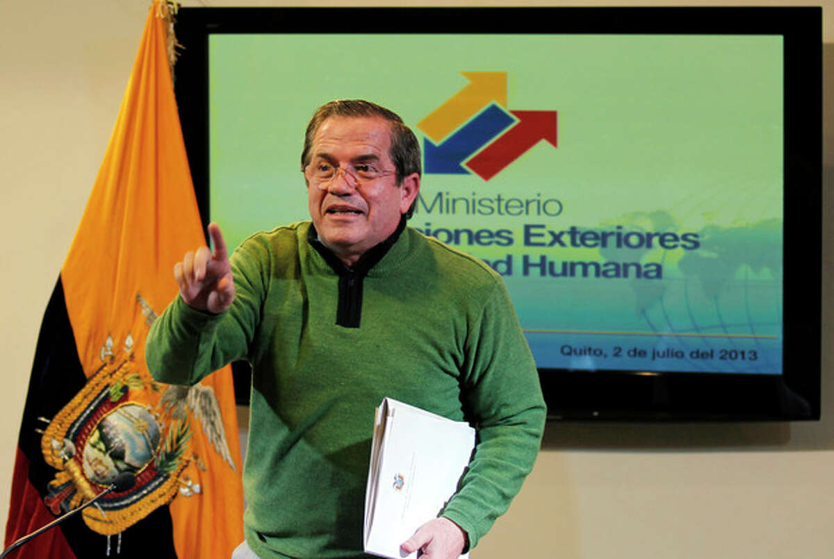 Ecuador's Foreign Minister Ricardo Patino gestures after a press conference in Quito, Ecuador, Tuesday, July 2, 2013. Patino said Ecuador is still considering the request for political asylum by NSA leaker Edward Snowden, but acknowledged that the former agent is under the jurisdiction of Russia's government. (AP Photo/Dolores Ochoa)