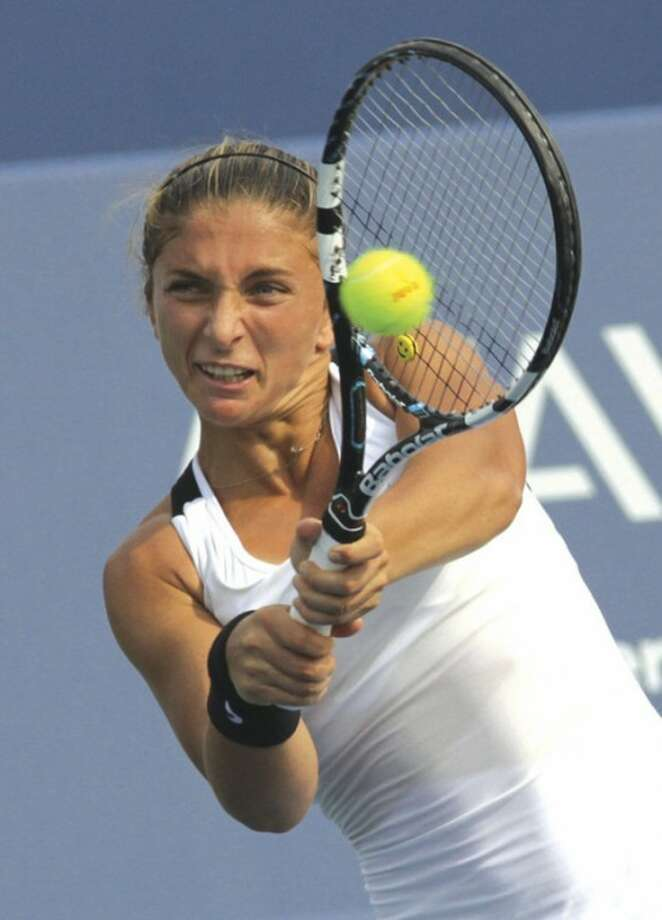 Sara Errani, of Italy, returns a volley to Venus Williams during a match at the Western & Southern Open tennis tournament on Thursday, Aug. 16, 2012, in Mason, Ohio. Williams won 6-3, 6-0. (AP Photo/Tom Uhlman)