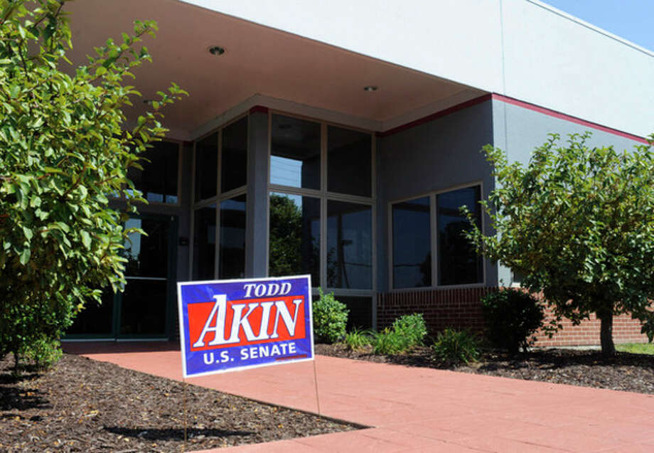"""A campaign sign stands outside the Senate campaign office of U.S. Rep. Todd Akin, R-Mo., Tuesday, Aug. 21, 2012 in Chesterfield, Mo. Rep. Akin has come under pressure to abandon his Senate compaign after his comments that women's bodies can prevent pregnancies in cases of """"legitimate rape"""". (AP Photo/Bill Boyce) / FR84052AP"""
