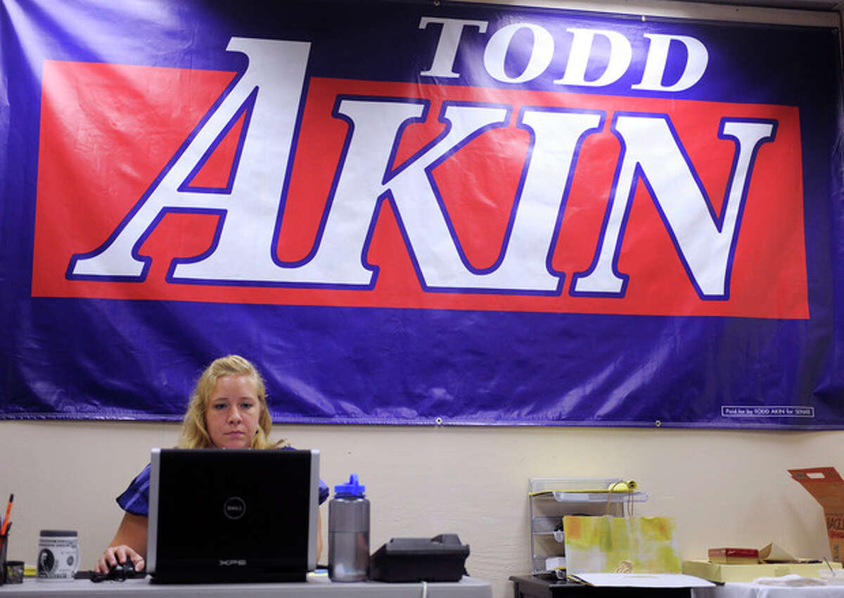 """Alaina Carnan of Lexington, Ky., works in the Senate campaign office of U.S. Rep. Todd Akin, R-Mo., Tuesday, Aug. 21, 2012 in Chesterfield, Mo. Akin has come under pressure to abandon his Senate compaign after his comments that women's bodies can prevent pregnancies in cases of """"legitimate rape"""". (AP Photo/Bill Boyce)"""