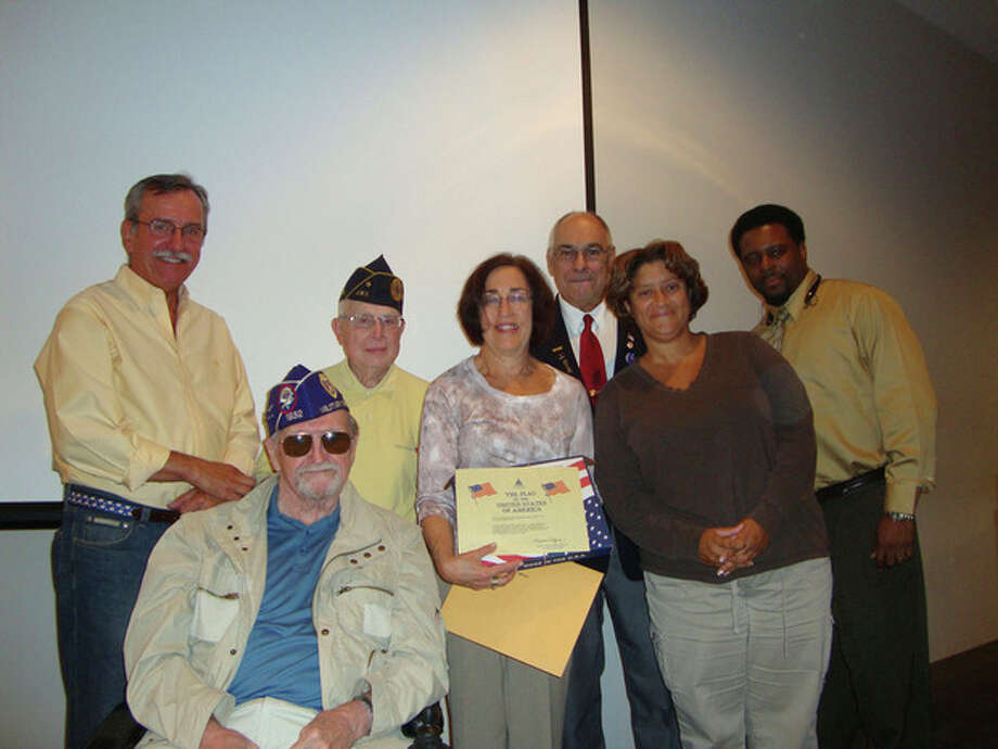 Dr. Susan Marks with members of the Norwalk Veterans Memorial Committee and Jarvin Johnson (rear right), veterans affairs specialist for Congressman Jim Himes, D-4. The committee honored Marks for her dedication to servicemen and servicewomen by presenting her with an American flag that was flown over the Nation's Capitol.