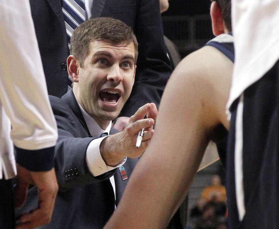 FILE - In this March 15, 2013 file photo, Butler coach Brad Stevens gives his team instruction during a timeout in the first half of an NCAA college basketball game against La Salle at the Atlantic 10 Conference tournament in New York. The Boston Celtics announced Wednesday, July 3, 2013, that Stevens was hired as the team's head coach, replacing Doc Rivers, who was traded to the Los Angeles Clippers. (AP Photo/Mary Altaffer, File) / AP