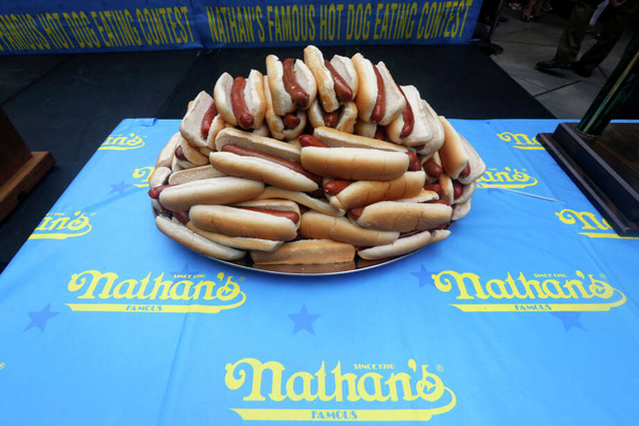 Hot dogs are on display during the official weigh-in for the Nathan's Fourth of July hot dog eating contest, Wednesday, July 3, 2013 at City Hall park in New York. (AP Photo/Mary Altaffer) / AP