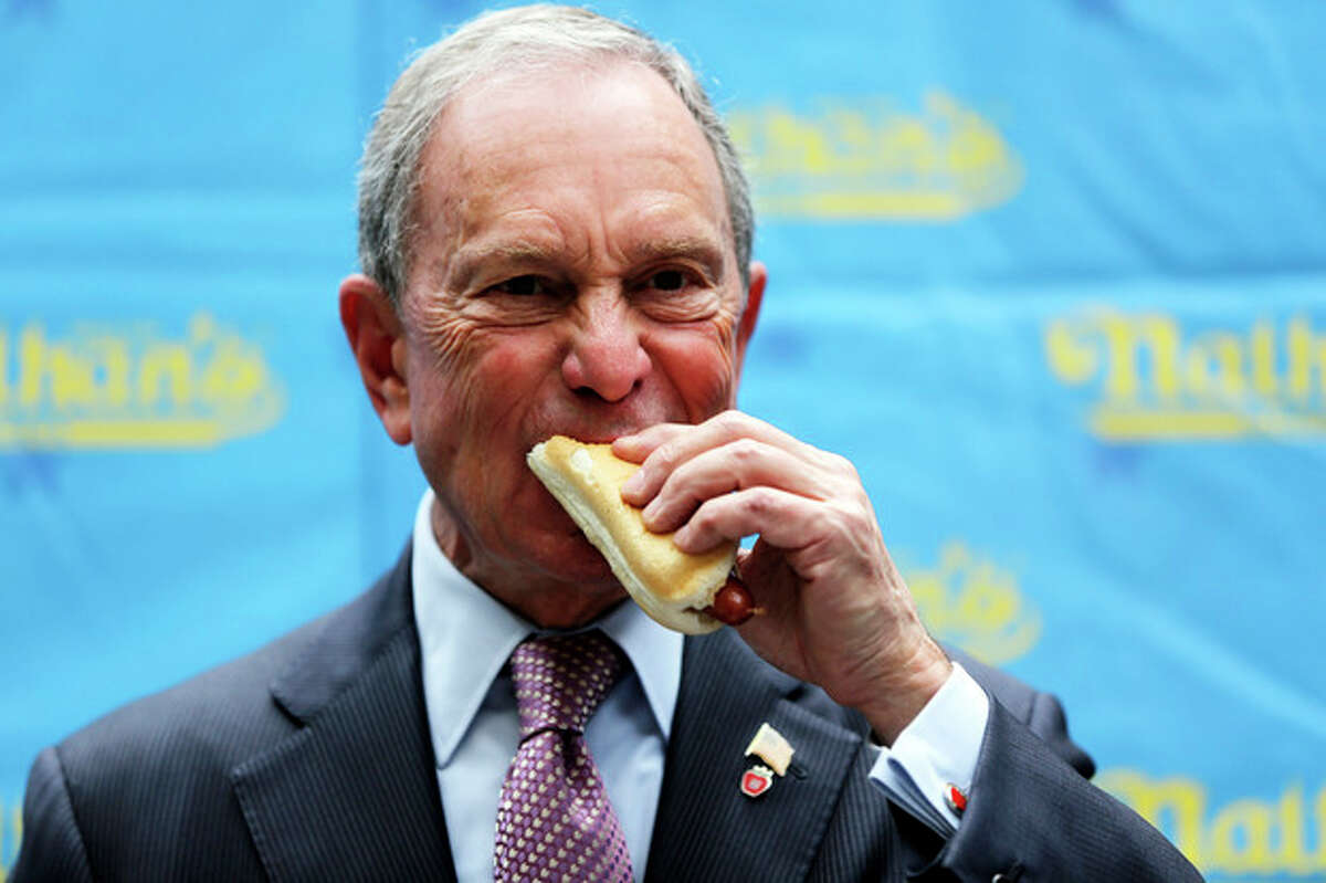 New York City Mayor Michael Bloomberg eats a hot dog during the official weigh-in for the Nathan's Fourth of July hot dog eating contest, Wednesday, July 3, 2013 at City Hall park in New York. (AP Photo/Mary Altaffer)