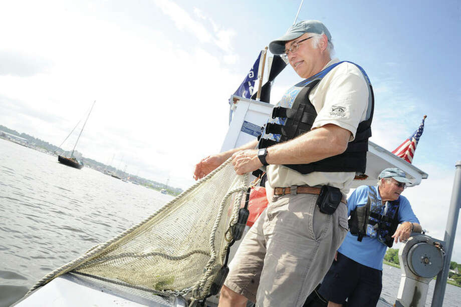 Hour photo/Matthew VinciPete Fraboni, Associate Director of Harbor Watch puts down the net to get a measure of species from the bottom population of the sound.