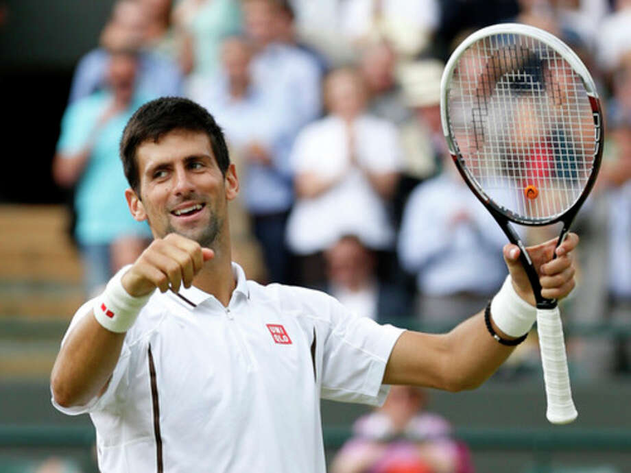 Novak Djokovic of Serbia reacts after beating Tomas Berdych of the Czech Republic in a Men's singles quarterfinal match at the All England Lawn Tennis Championships in Wimbledon, London, Wednesday, July 3, 2013.(AP Photo/Sang Tan) / AP