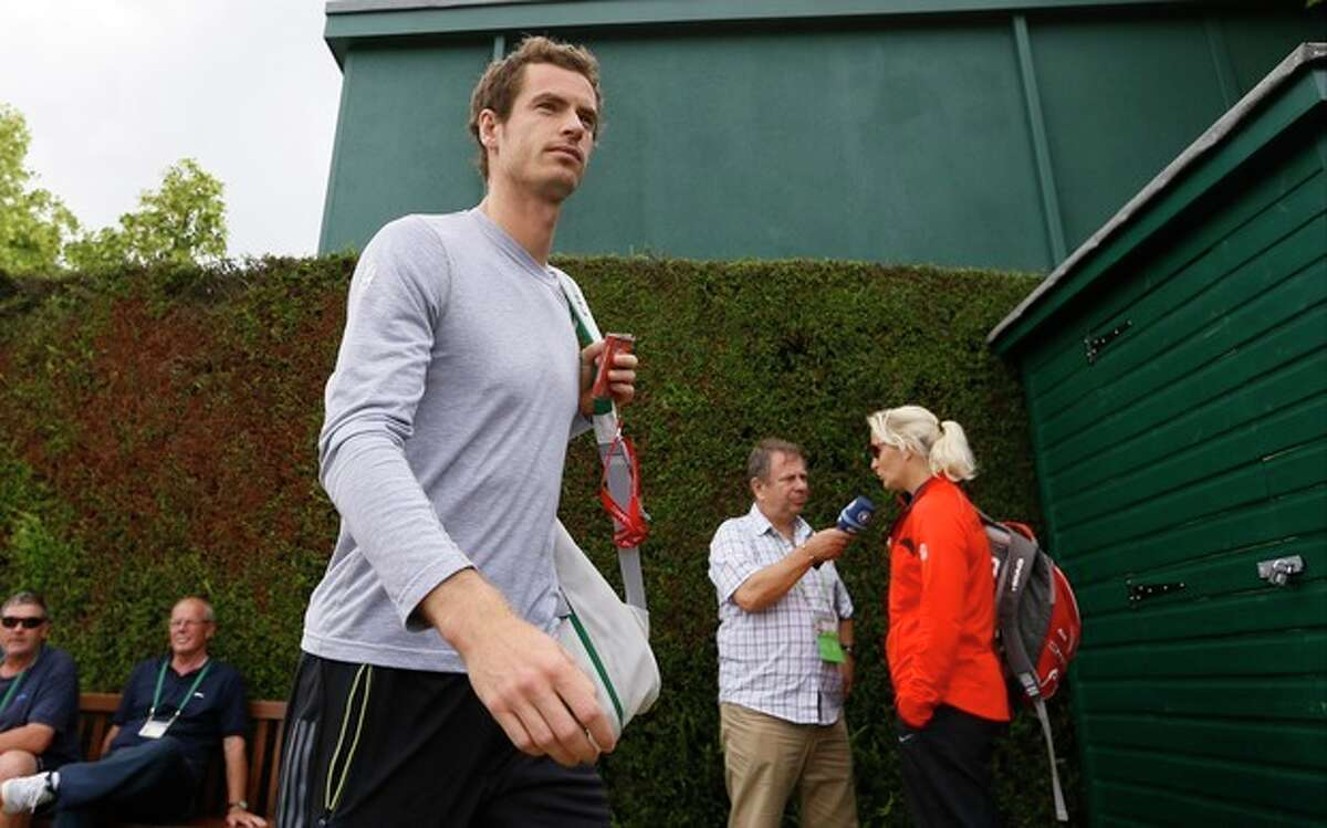 Andy Murray of Britain arrives for a practice session ahead of his Men's singles semifinal match on Friday at the All England Lawn Tennis Championships in Wimbledon, London, Thursday, July 4, 2013. (AP Photo/Kirsty Wigglesworth)