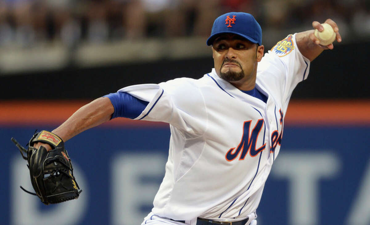 FILE - In this file photo taken Aug. 11, 2012, New York Mets' Johan Santana pitches for the first time since July 20 in baseball game in New York. He is headed to the disabled list and not expected to pitch again this season. General manager Sandy Alderson said Wednesday, Aug. 22, 2012, that the left-hander was going on the 15-day DL with inflammation in his lower back. (AP Photos/Henny Ray Abrams, file)