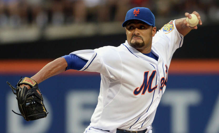 FILE - In this file photo taken Aug. 11, 2012, New York Mets' Johan Santana pitches for the first time since July 20 in baseball game in New York. He is headed to the disabled list and not expected to pitch again this season. General manager Sandy Alderson said Wednesday, Aug. 22, 2012, that the left-hander was going on the 15-day DL with inflammation in his lower back. (AP Photos/Henny Ray Abrams, file) / FR151332 AP