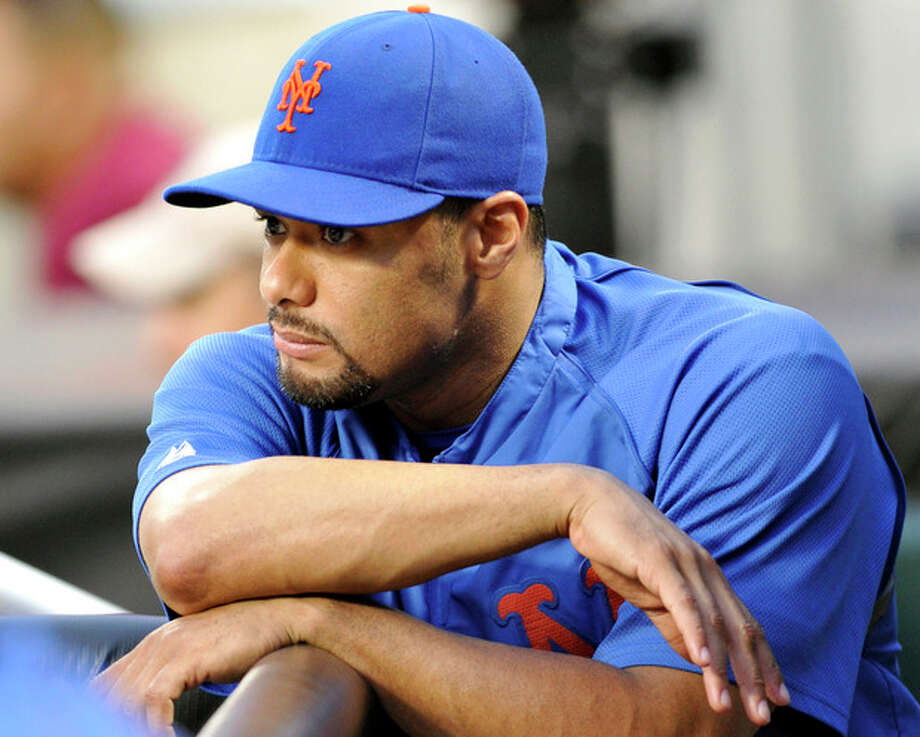 FILE - In this file photo taken Aug. 10, 2012, New York Mets pitcher Johan Santana watches from the dugout a baseball game in New York. Santana is headed to the disabled list and not expected to pitch again this season. General manager Sandy Alderson said Wednesday, Aug. 22, 2012, that the left-hander was going on the 15-day DL with inflammation in his lower back. (AP Photo/Bill Kostroun, file) / FR51951 AP