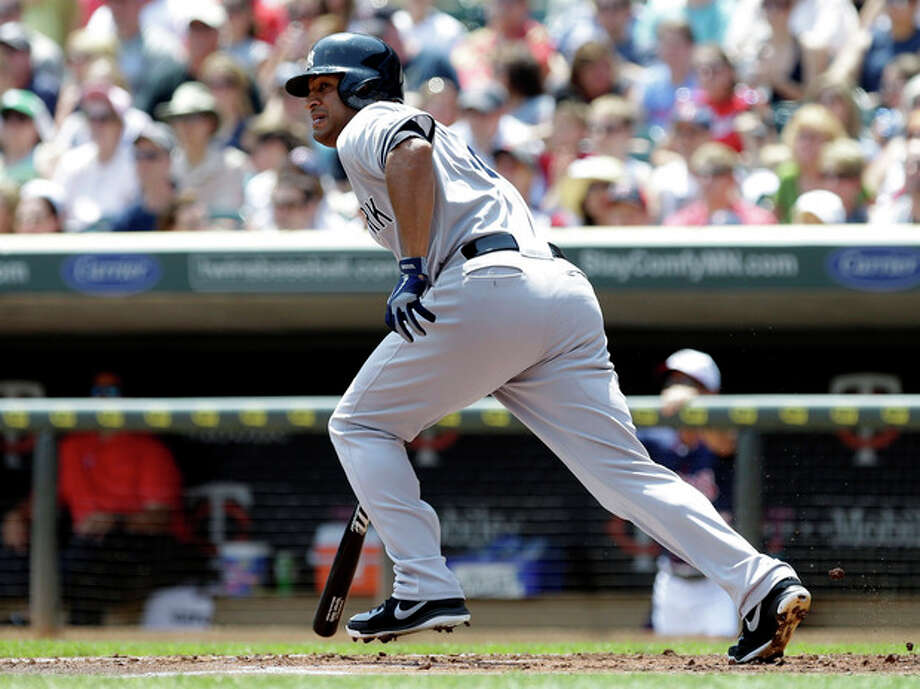 New York Yankees' Vernon Wells heads to first on a two-run single off Minnesota Twins pitcher Kyle Gibson in the first inning of a baseball game, Thursday, July 4, 2013, in Minneapolis. (AP Photo/Jim Mone) / AP