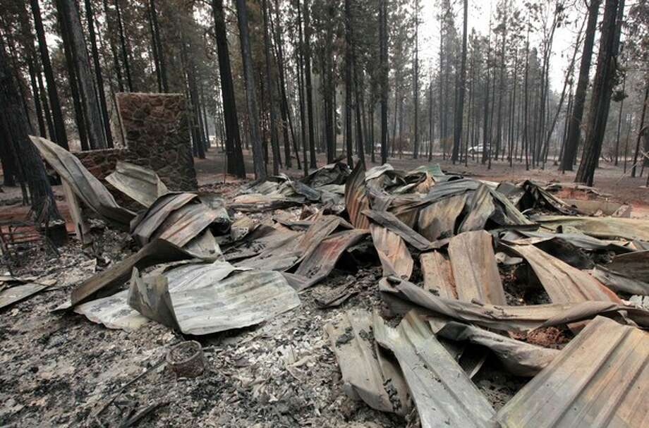 The burned remains of a home destroyed by a Ponderosa fire are seen near Manton, Calif., Monday, Aug. 20, 2012. More than 1,400 fire fighters are battling the fire that has destroyed seven homes, burned 23 square miles. The fire that started Saturday is just 5 percent contained. (AP Photo/Rich Pedroncelli) / AP