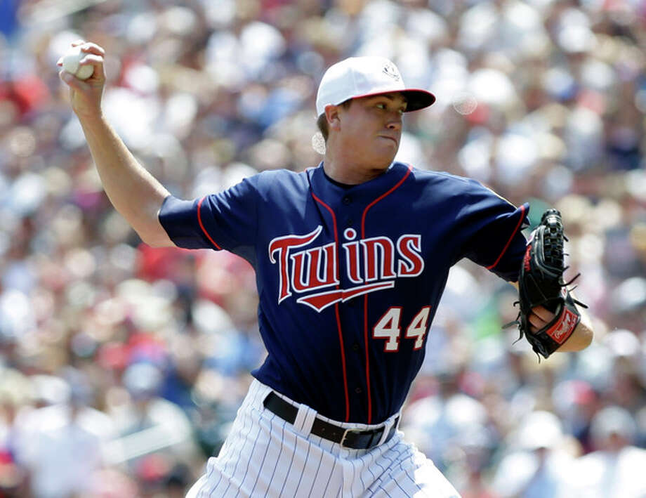 Minnesota Twins pitcher Kyle Gibson throws against the New York Yankees in the first inning of a baseball game, Thursday, July 4, 2013, in Minneapolis. (AP Photo/Jim Mone) / AP