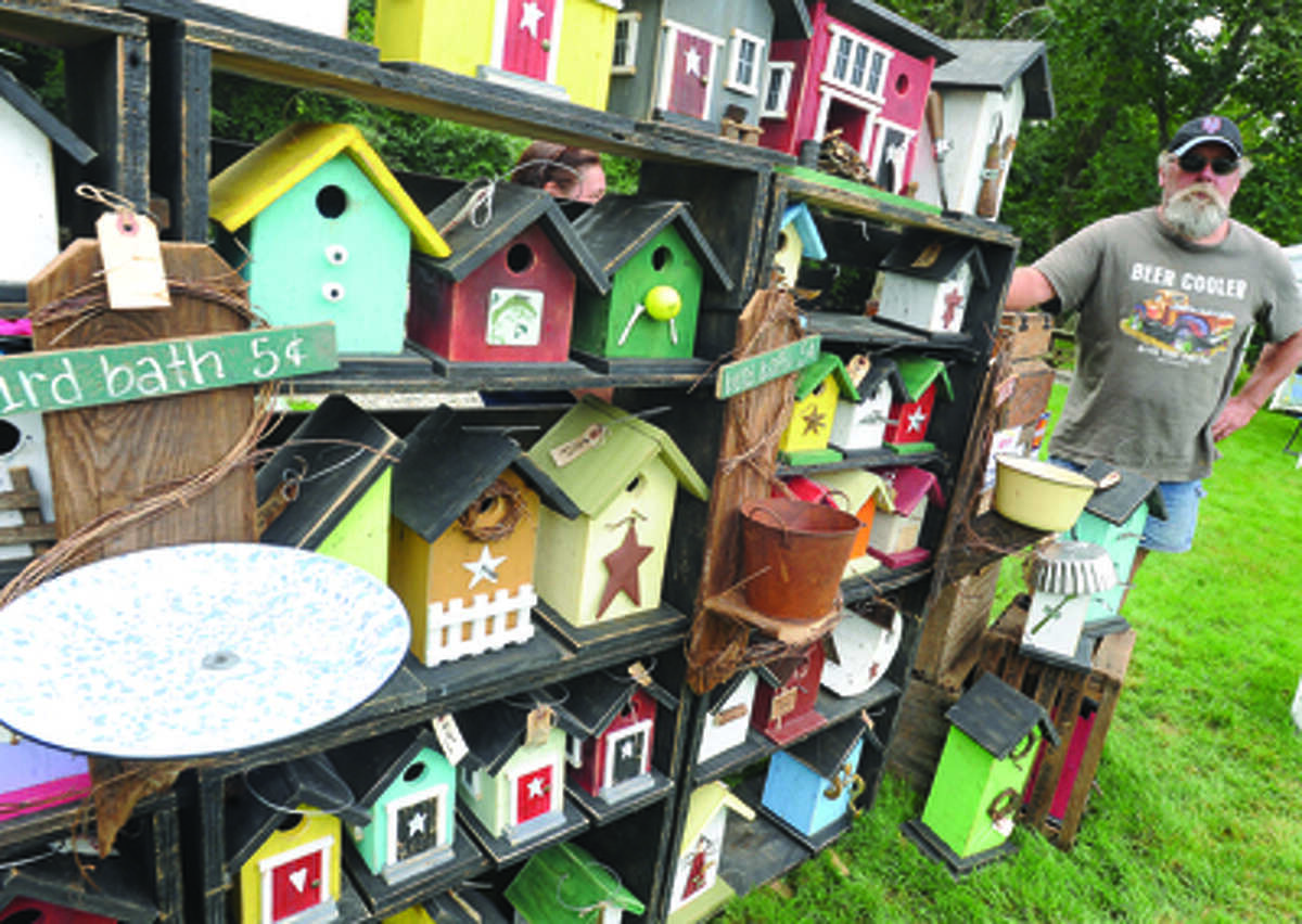 Fred Jakubiac with his hand crafted birdhouses at the Cannon Grange 80th annual agricultural fair in Wilton.