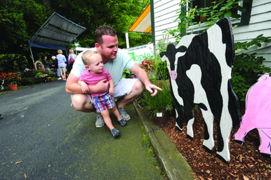 Matt Scully and his son Ronan, 2, at the Cannon Grange 80th annual agricultural fair in Wilton.