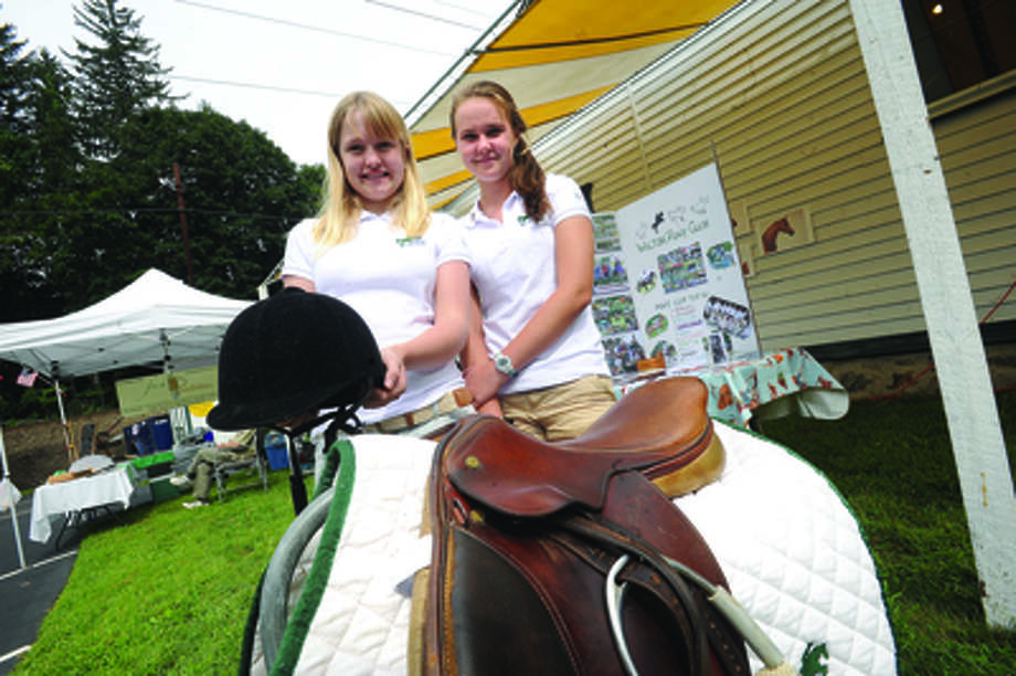 Courtney Hynes, 14, and Ady Fleitz, 15, are members of the Wilton Pony Club at the Cannon Grange 80th annual agricultural fair in Wilton.