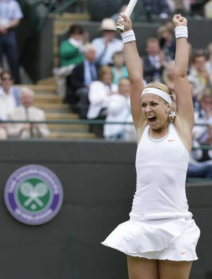 Sabine Lisicki of Germany reacts as she wins a Women's singles quarterfinal match against Kaia Kanepi of Estonia at the All England Lawn Tennis Championships in Wimbledon, London, Tuesday, July 2, 2013. (AP Photo/Alastair Grant)