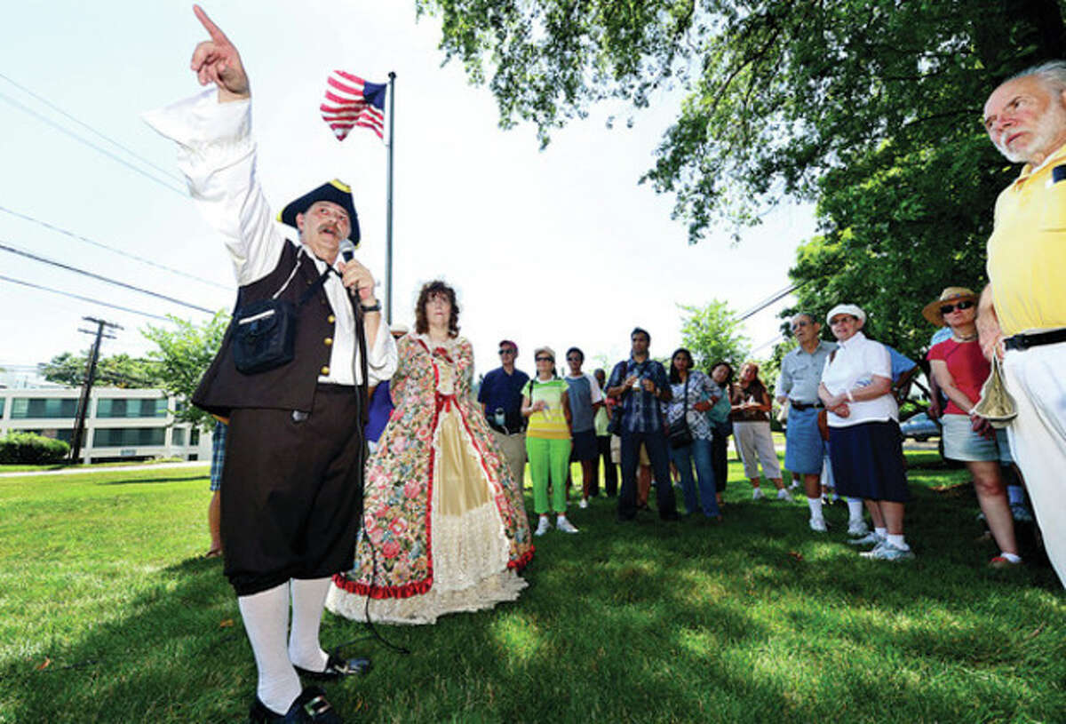 Edward and Madeleine Eckert gives a historical tour of the Norwalk Town Green and surrounding neighborhood during the Norwalk Historical Society's Independence Day celebration at the Mill Hill complex Thursday. Hour photo / Erik Trautmann
