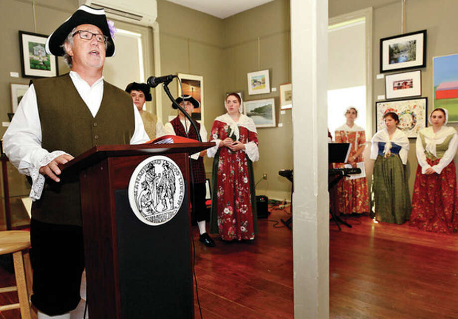 Hour photo /Erik TrautmannTown Clerk Rick McQaid reads the Declaration of Independence during the Norwalk Historical Society's Independence Day celebration at the Mill Hill complex Thursday. / (C)2013, The Hour Newspapers, all rights reserved