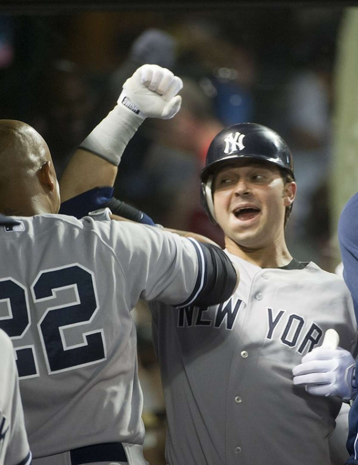 Nick Swisher of the New York Yankees, celebrates his seventh inning two-run home run off Cleveland Indians reliever Tony Sipp, with Andruw Jones (22) during a baseball game in Cleveland, Friday, Aug. 24, 2012. (AP Phil Long)