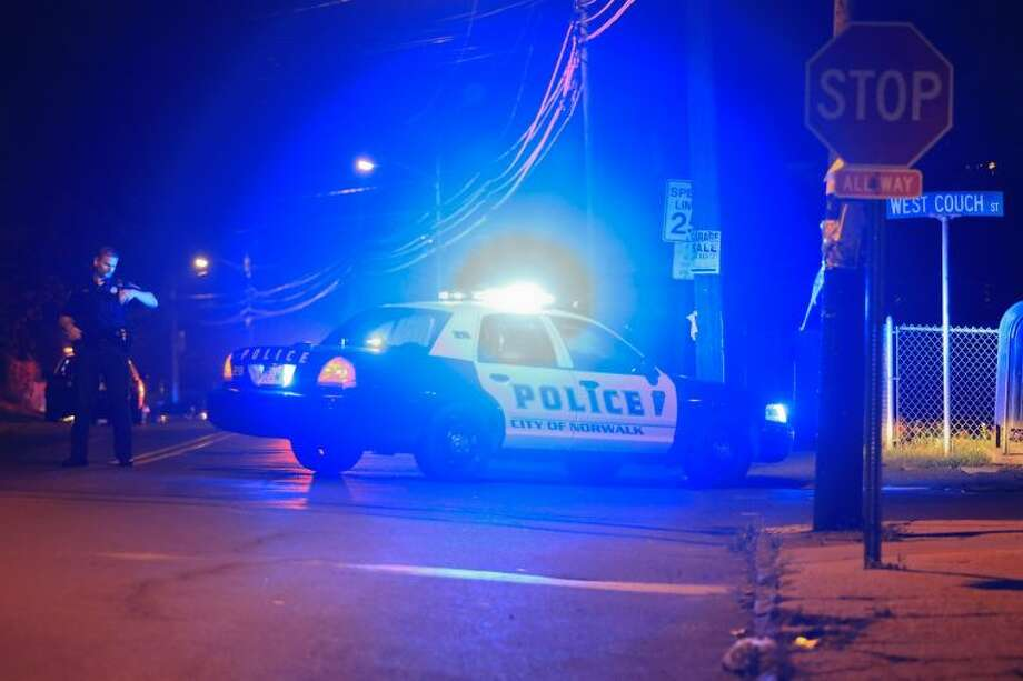 Police investigate a reported shooting on Taylor Avenue Thursday night.