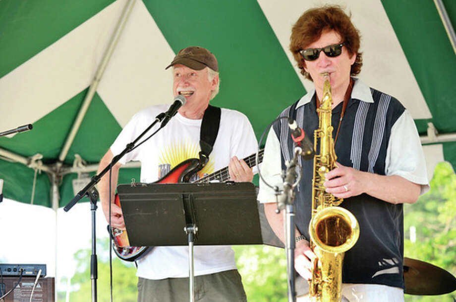 Ed Wright and Crispen Cioe play with MOJO! at the Independence Day celebration at Bailey Beach Thursday.Hour photo / Erik Trautmann / (C)2013, The Hour Newspapers, all rights reserved