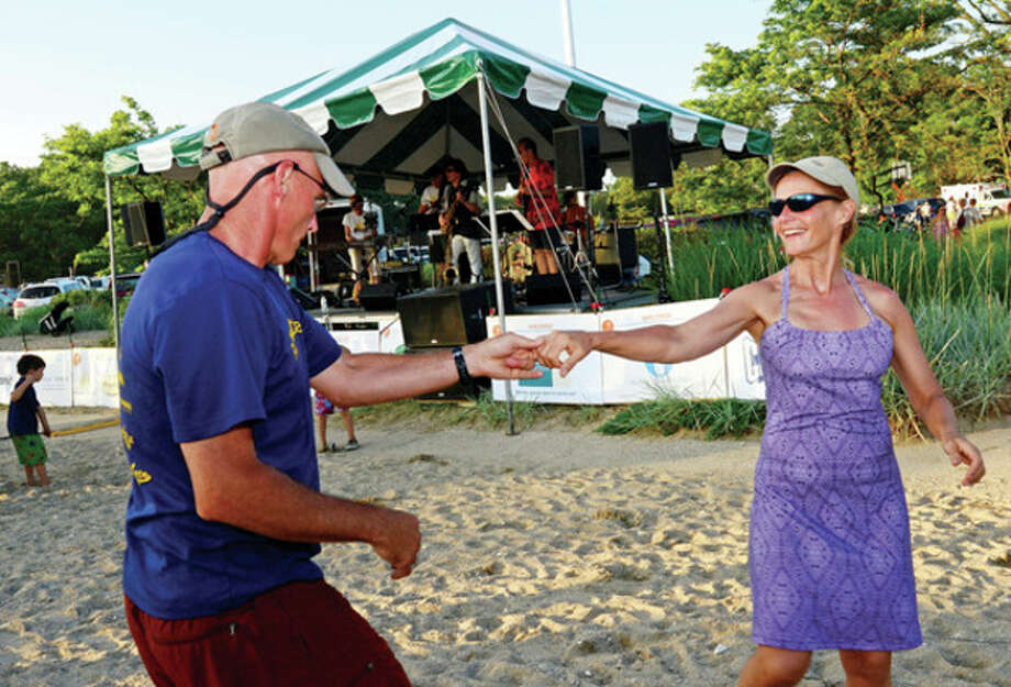 Diana Edwards and Brian Joly enjoy the Independence Day celebration at Bailey Beach Thursday.Hour photo / Erik Trautmann / (C)2013, The Hour Newspapers, all rights reserved
