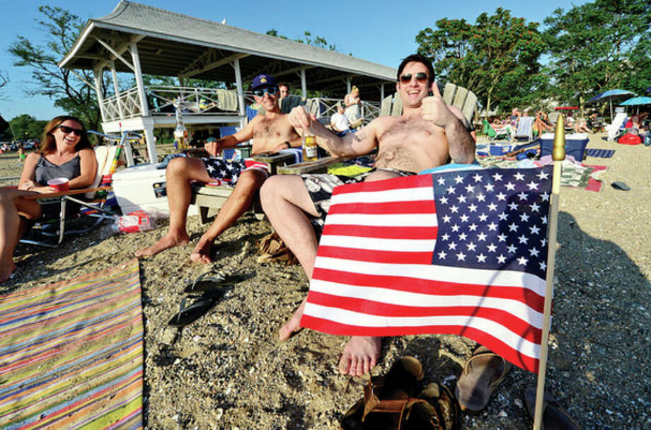 Hour photo / Erik TrautmannRowaytonites including Seth Webster and Andrew Diloreto enjoy the Independence Day celebration at Bailey Beach Thursday. / (C)2013, The Hour Newspapers, all rights reserved